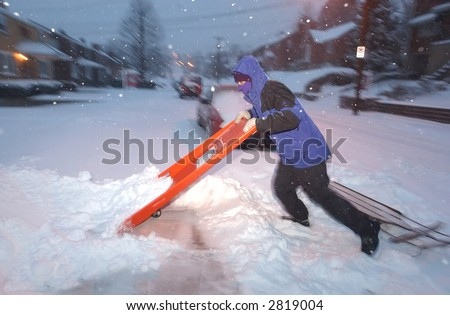 Shoveling snow from a sidewalk - stock photo