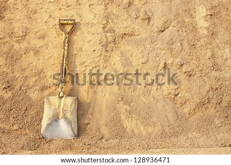 Shovels on pile of dry soil  at a construction site.