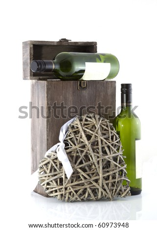 Show case of wine bottles on a white background.