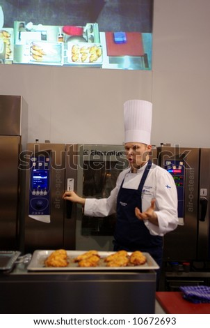 Show-cooking time in exhibit - stock photo
