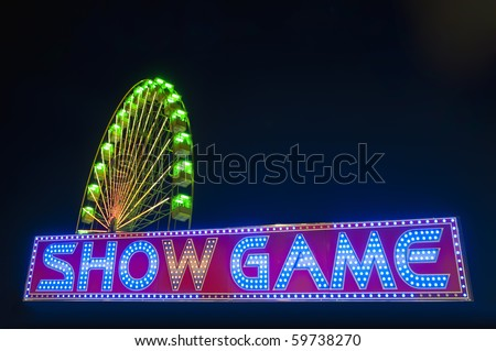 Show Game neon sign at night - stock photo