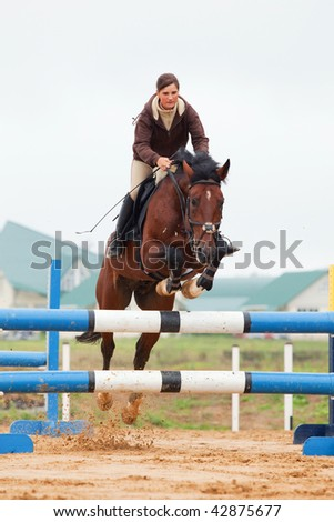 show jumping - young girl and horse