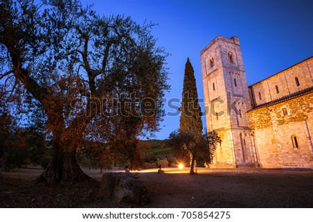Show of colors - Abbey of Sant'Antimo, Castelnuovo dell'Abate, Montalcino, Tuscany, Italy, Europe While the sun has set, the blue hours and artificial lights spread their colours over the Abbey.