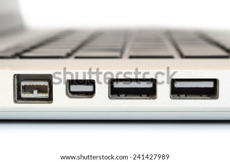 Show sideview closeup up of computer laptop selective focus on firewire port - stock photo