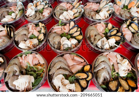 showcase of seafood in the Cooking pot, Seafood. Prepared Shellfish. Mediterranean. - stock photo