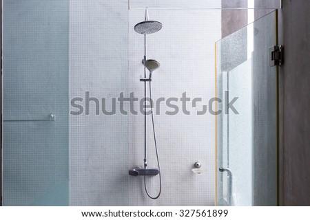 shower head in bathroom, design of home interior outdoor bathroom with open roof - stock photo