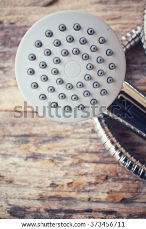 Shower head on wood background