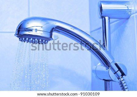 Shower head with running water - stock photo