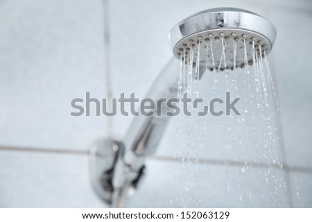 Shower in bathroom with water flowing - stock photo