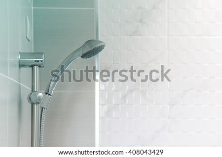 Shower on tile wall - stock photo