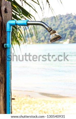 Shower out door on the beach for wash water sea - stock photo