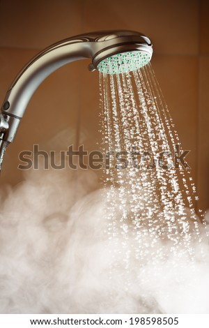 shower with flowing water and steam - stock photo