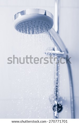 Shower with running water, tinted photo - stock photo