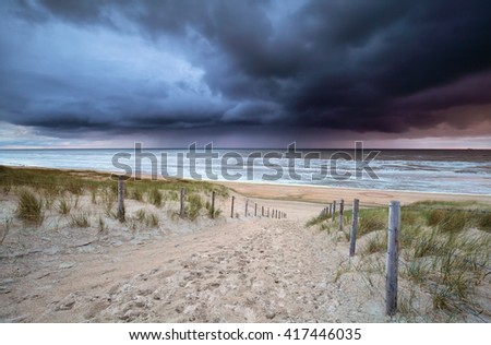 showers rolling over north sea at sundown, North Holland, Netherlands