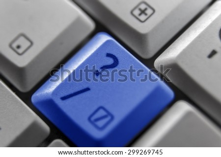 Showing a question mark button on a computer keyboard