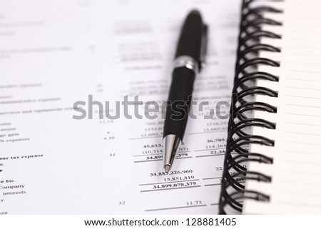Showing business and financial with pen on book
