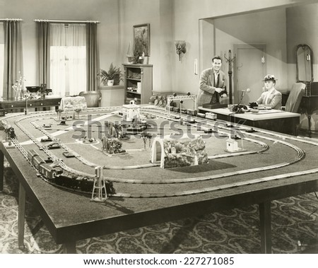 Showing off new toy train set - stock photo