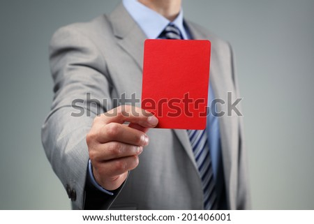 Showing the red card concept for bad business practice, exclusion or criminal activity - stock photo