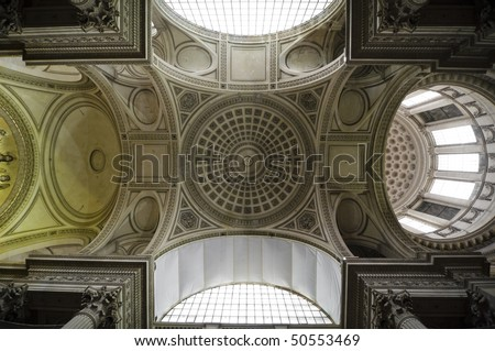 Showing the symmetry of the  ceiling of the Pantheon in Paris, France.  The ceiling is currently undergoing restoration and has some parts covered for safety - stock photo