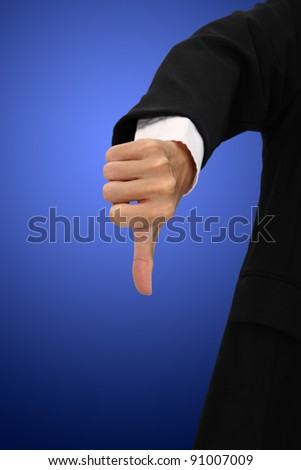 Showing thumb for non approval on blur body suit. - stock photo