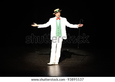 Showman,actor entertainer presenting show or product in the theatre or theater - stock photo