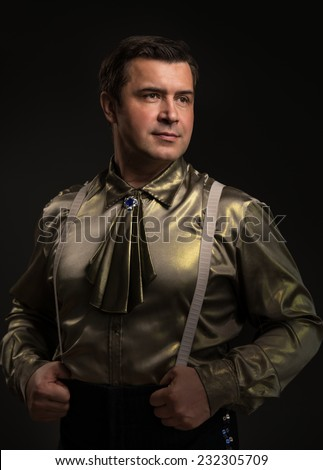 Showman on black background - stock photo
