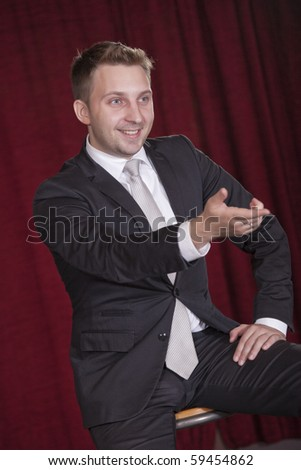 showman on the stage talking with audiences - stock photo