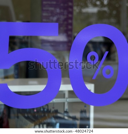 Showroom sign showing sales 50% off price - stock photo