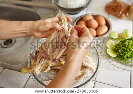 Shredded chicken for the ingredient for Soto, the traditional Indonesian chicken soup - stock photo