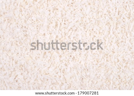 Shredded coconut as background texture - stock photo