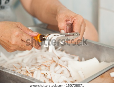 shredded coconut flakes close-up on painted wooden surface - stock photo