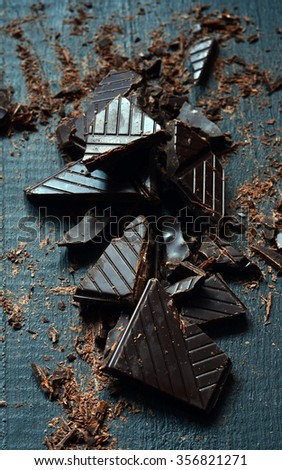 Shredded Dark Chocolate for Cooking on dark wooden background
