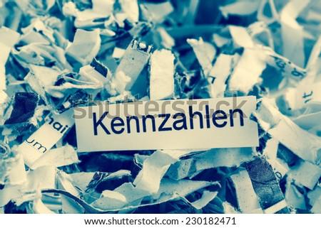 shredded paper for keyword metrics, symbol photo for data destruction, business and economic development - stock photo