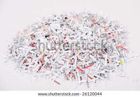 Shredded paper in a pile on a white background - stock photo