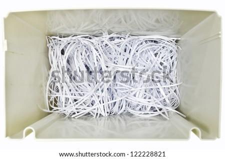 shredded paper in the shredder - stock photo