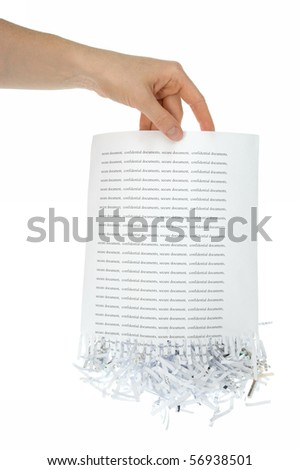Shredded paper, security white pile in hand - stock photo