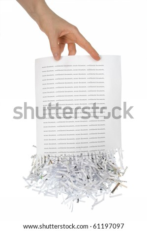 Shredded paper, security white pile in hand