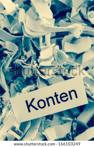 shredded paper tagged with accounts, symbol photo for finance, accounting and double-entry bookkeeping - stock photo