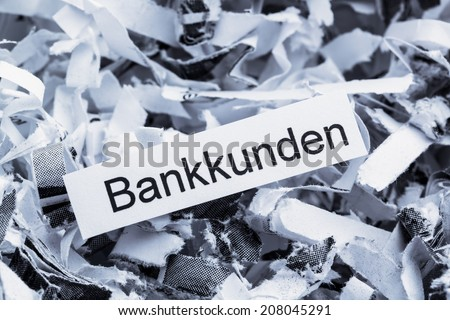shredded paper tagged with bank customers, symbol photo for destruction of data, customer data, and bank secrecy - stock photo