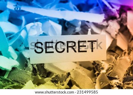 shredded paper tagged with secret symbol photo for data destruction, bank secret and economic espionage - stock photo