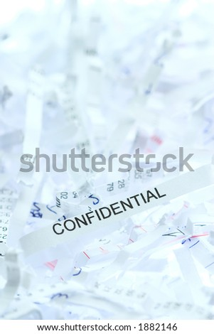 """Shredded paper with focus on the word """"Confidential"""" - stock photo"""