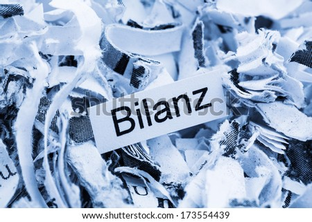 shredded paper with keyword balance, symbol photo for data destruction, accounting, and economic analysis - stock photo