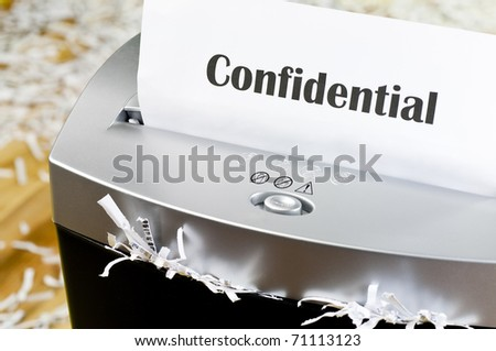 Shredding documents for security - stock photo