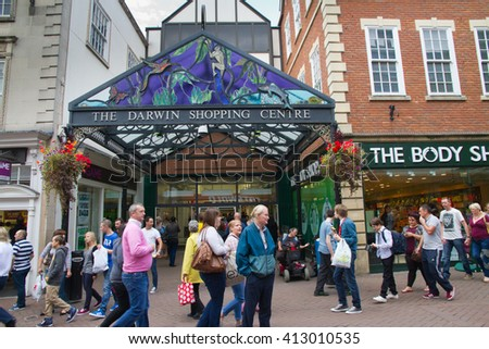 Shrewsbury, Shropshire, UK - September 28th, 2013: Shoppers outside the Darwin Shopping centre  built in 1989 and named after the famous botanist Charles Darwin who was born and educated in the town.  - stock photo