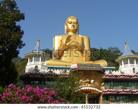 Shri-lanka, the Buddistsky Gold temple. Gold statue of the sitting Buddha