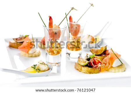 shrimp, an assortment of seafood, bacon, salmon, eggs, snacks, restaurant - stock photo