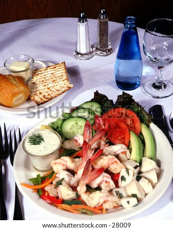 Shrimp and avacado dish on set table
