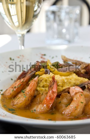 shrimp and grits with vegetables - stock photo
