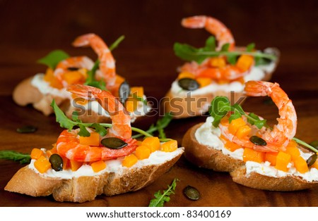 Shrimp and pumpkin toast with soft cheese, arugula and pumpkin seeds