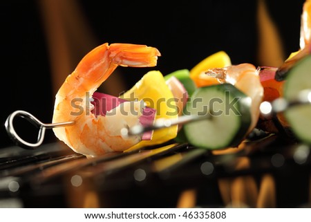 Shrimp and vegetable skewer on grill closeup - stock photo